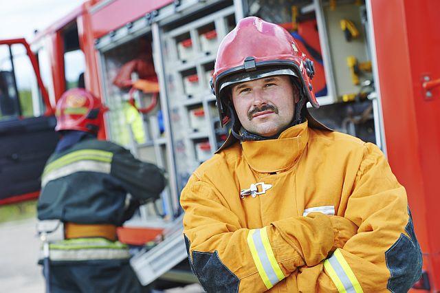 A fireman folds his arms